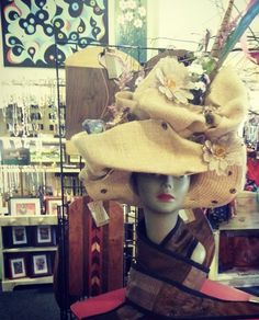 Kentucky Derby Hat - for sale - $50. Email me or go to The Roost, downtown Springfield IL. I made this out of burlap, peacock & pheasant feathers, bird nest, silk flowers, burlap flower. It is totally wearable! I wore it around for a while!