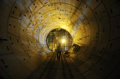 2013.04.03 - A Delhi Metro Rail Corporation employee walked through a tunnel at an underground construction site for the Janpath metro station in New Delhi Wednesday. (Sajjad Hussain/AFP/Getty Images) #túneles #tunnel