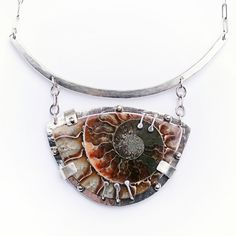 "Ammon (Tribe)    sterling silver & fossilized ammonite; 3"" w x 2"" h (setting); 16"" hammered collar & chain with handmade closure; all links soldered; ooak"