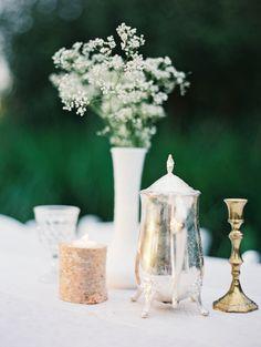 babys breath in milk vase and vintage accessories #tabledecor #weddingreception #weddingchicks http://www.weddingchicks.com/2014/02/20/beautiful-oregon-wedding/