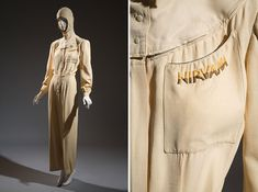 Aviatrix suit, hood and detail of pocket. This flight suit was designed for the chic aviatrix. The removable hood enables the wearer to transition from plane to country club, while vertical darts around the waist create a slightly fitted silhouette. An icon of the era, Amelia Earhart remains the most well-known of the many enthusiasts who popularized aviation as a sport for women during the 1930s. Ivory rayon shantung, circa 1939, USA, museum purchase
