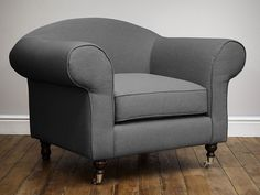 Gideon Upholstered Armchair - Deep padded foam and feather cushions create an inviting and luxurious space for you to sink into and unwind after a hard day - by www.livingitup.co.uk