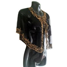 Gold embellished hand beaded cape, beautiful embellished all over. Ideal piece for any party. Wear with skinny legging, jeans or evening dress.  Product Information Description: (1)Style: cape,poncho,shrug (2)Combination forms: 1 Piece (1)Polyester (2)Hand Wash/Dry Clean (3)Beads/Embellished Size Detail: FREE SIZE S-XL (8-14 UK)   A little color shading maybe cause by the light difference and photograph skill. Thank You   If you would like more info or have any questions, please don...