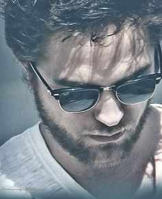 Robert Pattinson-I love his music, wish he'd put out...a CD that is.