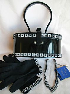 Beautiful Wilardy black lucite handbag with matching gloves, necklace and matchbook filled with emery boards..... I have died and gone to heaven!