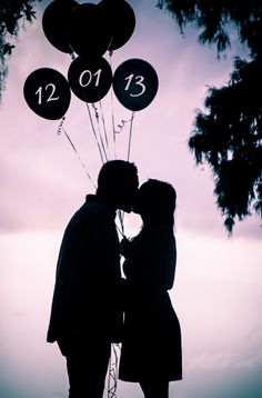Save the date photo. Photoshop the date of your wedding on balloons. #engagement #savethedate #silhouette