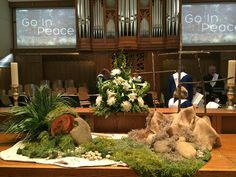 Easter Altar Idea. Tomb, left over palm display, three crosses, sheet moss and a light inside tomb. Love Overcomes: Doubt