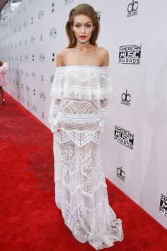 Gigi Hadid in a little white off the shoulder lace dress for the American Music Awards.
