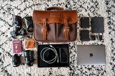 Our St. James's Street camera bag is modeled off of the revered English field bag. We pair brown bubble leather with triple layered canvas. Made in England. Thick Leather, Tan Leather, Prime Lens, Metal Bar, Camera Gear, Cheap Bags, Bubbles, England, Street