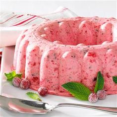Fluffy Cranberry Mousse Recipe -This is a delicious and pretty salad for the holidays, but it's so good that I serve it at other times, too. I got the recipe from a neighbor who had served it with a traditional turkey dinner. —Helen Clement, Hemet, California