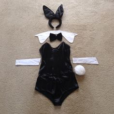 Playboy Bunny Costume - So Sexy!!!  Includes: silky black nylon/spandex bodysuit with boning & back zip for flattering fit; bunny ears headband (furry w/ satin lining; adjustable ear position); bow tie on elastic band; white cotton collar & cuffs; pin-on bunny tail. Worn once. Bodysuit & bunny ears are in LIKE NEW condition. Collar is slightly yellowing in some places. One cuff & bunny tail have discoloration in a few spots. ALL DISCOLORATION IS PICTURED. Intimates & Sleepwear