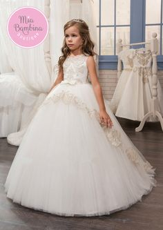 The Houston flower girl dress is a sleeveless ball gown for little girls. Tank bodice features delicate lace appliques and chic bows detailing. An elegant long multi layered tulle skirt with peplum ti