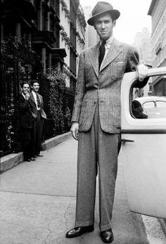 1939 James Stewart in Plaid Sport coat over dark pants. 1930s-1940s men's clothing and fashion.