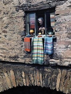 A woman sticks her head out of her bridge house window, in Ambleside, Lake District, Cumbria, England. photographer Clifton R. Adams) (The Bridge House today) Cumbria, Ambleside Lake District, Photo Chat, Window View, Through The Window, Clothes Line, Color Photography, Windows And Doors, Old Photos