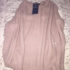 NWT Blush Ollie Sweater When ur mom buys you a sweater u already have LOOOL Ⓜ️ Trade ( ONLY BRANDY) Don't comment if you don't have brandy to trade  Will only trade for other ollies, brandy dresses, rompers, eve shorts Brandy Melville Other