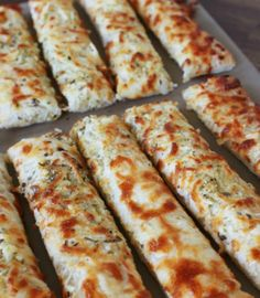 Grab your favorite brand of pizza dough to make our killer cheesy garlic sticks! You'll never order breadsticks again! - Everyday Dishes & DIY