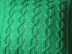 Emerald green hand knitted Aran design cushion by JenStarKnits, £39.99