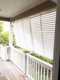 Our bahama shutters look great on this covered porch. They also help with the sunlight and nosy neighbors.