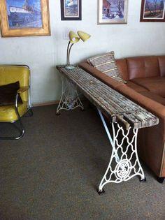 Sofa table using vintage sewing machine legs
