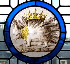 Heraldic glass detail in the Royal Château de Blois, Loire Valley, France - Badge of Louis XII, King of France