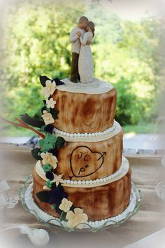 Oh. My. Goodness. I totally want this cake if Jon & I ever have a big anniversary celebration! That is one of my all time favorite Willow Tree figures (which I collect)