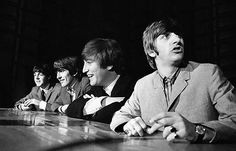 The Beatles, (L-R) Paul McCartney, George Harrison, John Lennon and Ringo Starr are seen during their first tour of the U.S. in this photograph taken by Mike Mitchell and auctioned by Christie's in...