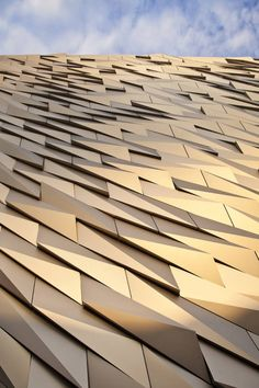 Over 3000 individual silver anodized aluminium shards make up the facade | Titanic Belfast, CivicArts & Todd Architects