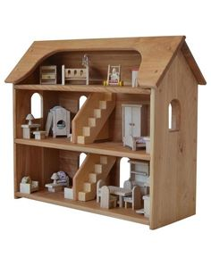 This beautiful heirloom-quality wooden dollhouse is made in Maine and is sturdy enough to provide generations of play. Your children will love Seri's Dollhouse, with three spacious floors, space for s Dollhouse Toys, Wooden Dollhouse, Wooden Dolls, Dollhouse Family, Bookshelf Dollhouse, Selling Furniture, Barbie Furniture, Dollhouse Furniture, Furniture Plans