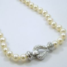 16 inch Pearl Necklace with a Diamond Clasp.$675