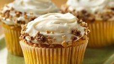 Mmm!  Toasted and sugared nuts top cream cheese frosting on sweet and spicy pumpkin cupcakes.
