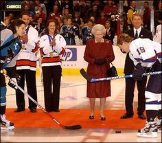 The Queen drops the puck to start an ice hockey game between the San Jose Sharks and the Vancouver Canucks in Vancouver, 2002 Hockey Games, Ice Hockey, San Jose Sharks, Vancouver Canucks, Toronto Maple Leafs, Happy Things, Goalkeeper, Queen Elizabeth Ii, British Royals