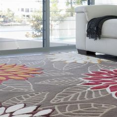 Handmade silk and wool rug, neutrals with a pop of red and orange by The Rug Establishment.