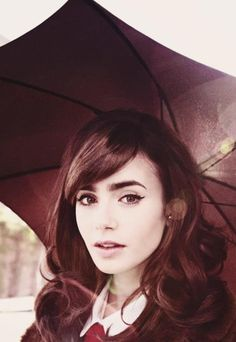 Lily Collins...this would be a cute senior picture!