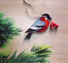 Stained glass bird Christmas ornament                                                                                                                                                      More