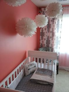 Love the pom-pom thingy's above the crib.