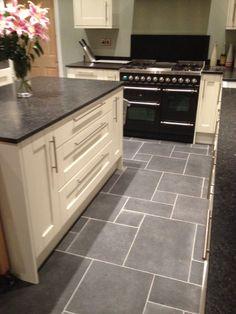 The Rough Black Limestone compliments the cream kitchen and dark granite worktops wonderfully.