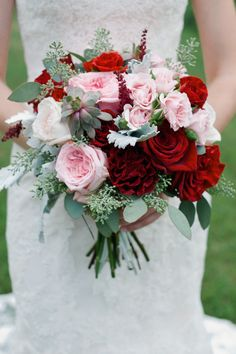 red and pink bouquet of roses and garden roses with succulents, dusty miller and seeded eucalyptus