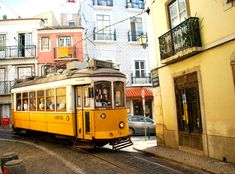 Top 10 Things to do in Lisbon, Portugal | Via travelerslittletreasures | 06.01.2015 - One thing which is really special is that they still have those old trams from the past with a wooden interior. The tram 28E is very popular for the tourists because it goes up and down the small streets of Alfama. #Portugal