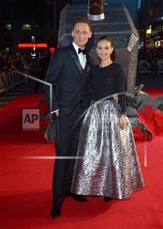 "Actors Tom Hiddleston and Natalie Portman poses for photographers as they arrive on the red carpet for the World Premiere of ""Thor: The Dark World"" in Leicester Square, London, on Tuesday Oct. 22, 2013. (Photo by Jon Furniss/Invision/AP Images)"