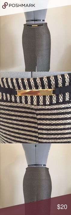 Cortifiel Woman Skirt Purchased two years ago. Never worn . 100% poly. I never buy poly but it was such a rich looking skirt. Tweedy looking. Blk/Cream with gold thread.  Front slit and metal detail. Side zipper. Size 4 European sizing. Perfect with black turtle and boots. Cortefiel Woman Skirts Pencil