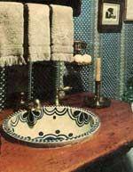 Talavera bathroom sink.. I want that!