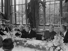 Churchill and Maisky (centre) share a toast at a luncheon at the Soviet embassy in London in August 1941
