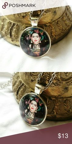 "Frida Kahlo Necklace Metal: silver tone Pendant Size: 1"" in diameter Chain: 20""  Willing to accept reasonable offers! Bright Eyes Jewelry Necklaces"