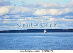 Stock Photo: Small sailboat on the sea sailing to the horizon on beautiful summer day. -