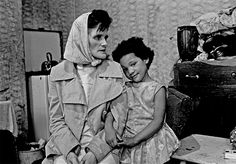 Mrs Chichockjy and daughter in Liverpool 8. 'The housing minister [Peter Walker] came round here and said it wasn't fit for human habitation, and I'm still here.', Liverpool (july 1971) Gimme Shelter: hard lives in British cities 1969-72