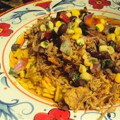 I usually use a pork loin.  I use the meat plain as a dish, then leftovers for some kind of mexican food or for stuffed baked potatoes.    Slow Cooker Carnitas Recipe