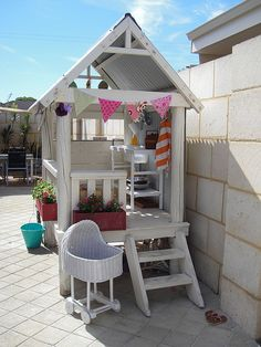 Cute playhouse idea for the girls. I need to buy a saw and make a workbench!!