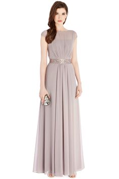 A truly sumptuous maxi gown perfect for any extra special occasion. The Lori Lee Maxi Dress features a sheer bodice lined with a soft slip for a demure and feminine allure. The waist is cinched with a lustrous waist tie embellished with faux gems for an opulent aesthetic. The back of the dress features a graceful keyhole detail and the skirt is fully lined for party perfect movement. Dress length from underarm to hem is 128cm/50.5 inches.