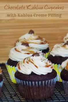 A Chocolate Kahlua Cupcake filled with a Kahlua Creme filling topped with a buttercream frosting and a kahlua syrup drizzle.