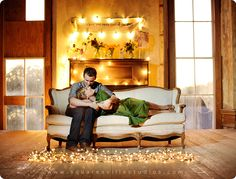 romantic engagement picture with string lights